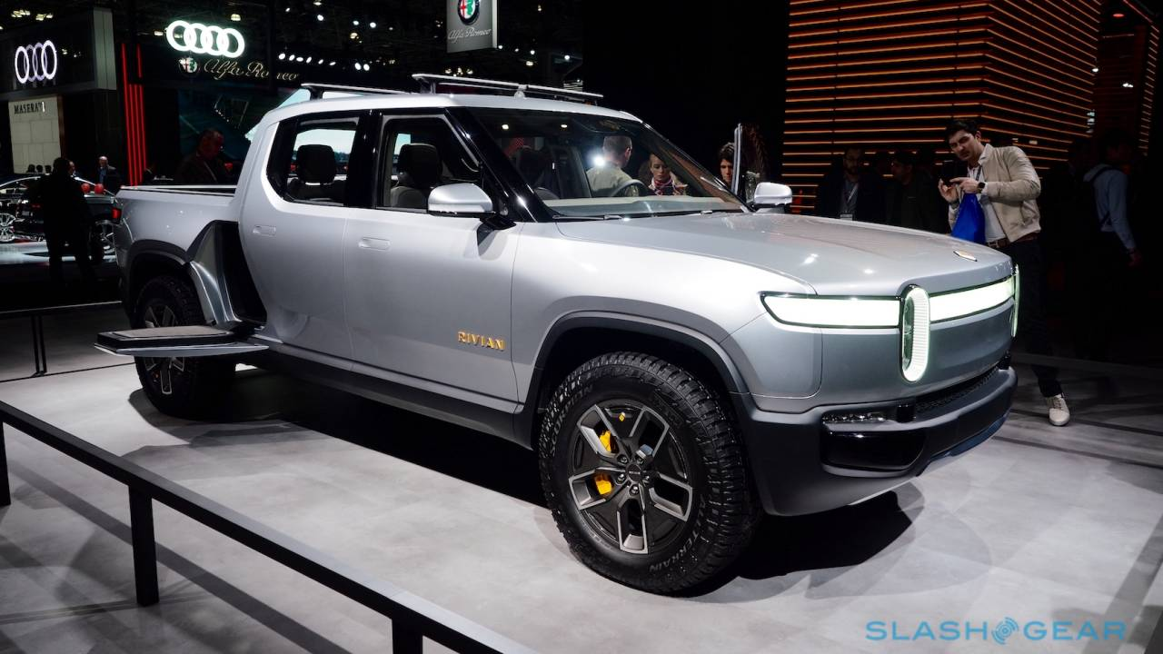 Rivian surprises with lower prices for its electric pickup and SUV